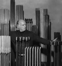 Harry Bertoia pictured with a selection of his Sonambient Sculptures